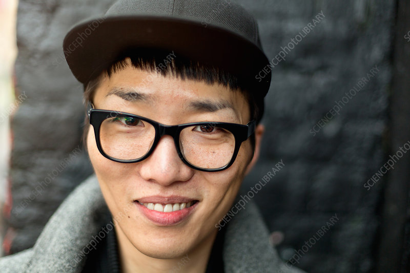 Bespectacled young man with cap