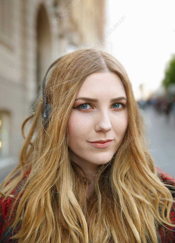 Blond young woman with headphones