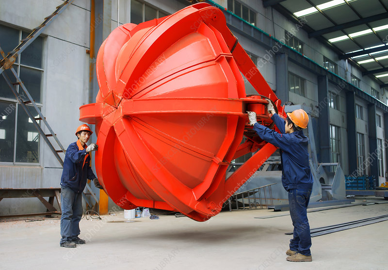 Workers in crane manufacturing facility