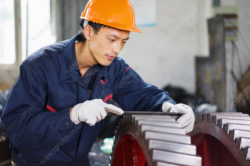 Worker in crane manufacturing facility