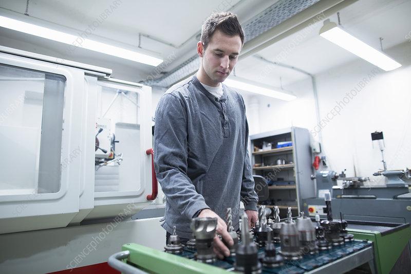 Technician choosing drill bit