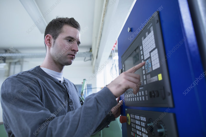 Technician using control panel