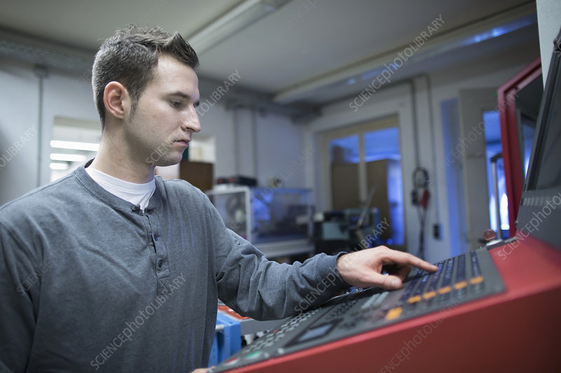 Technician using control panel