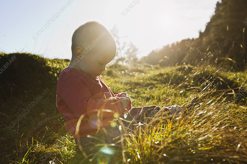 Girl sitting in field
