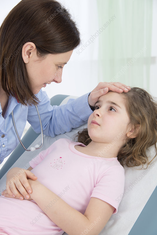 Doctor caring for girl