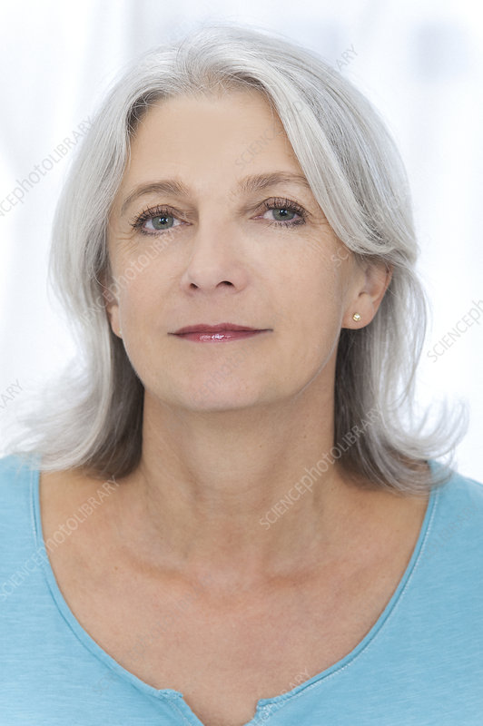 Mid adult woman looking at camera