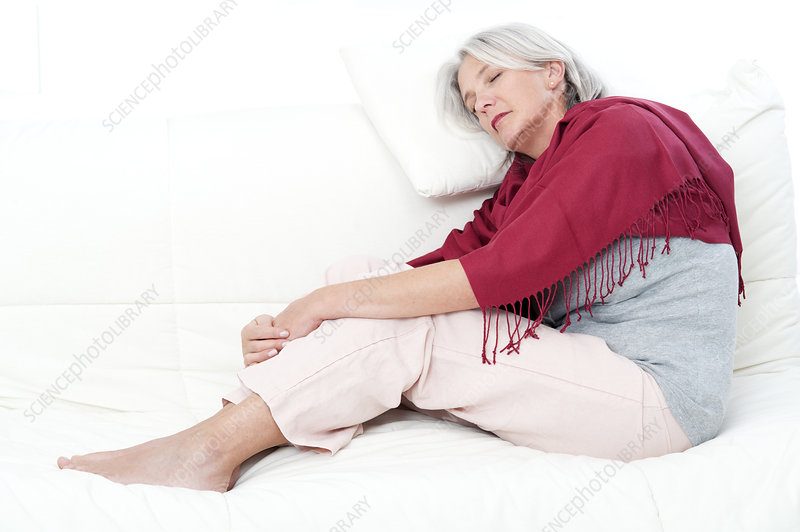 Woman lying on bed asleep