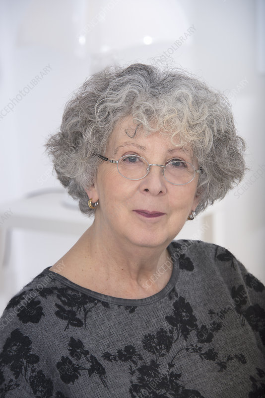 Woman wearing eyeglasses with grey hair