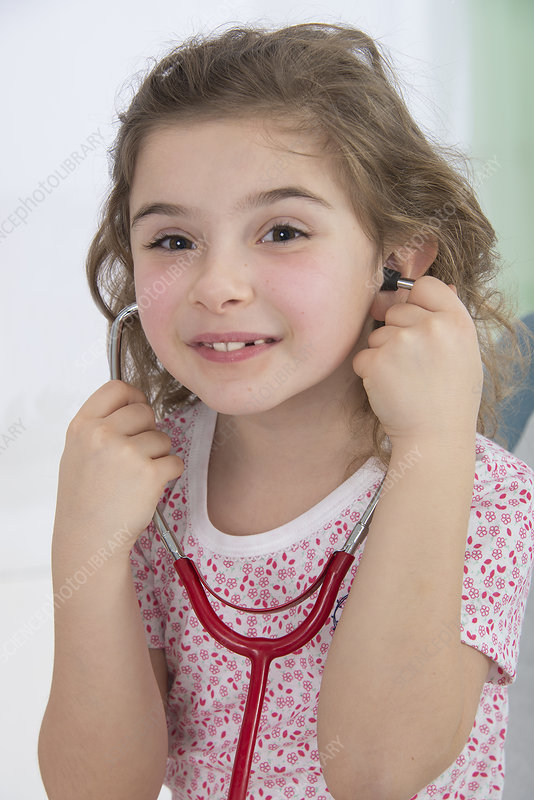 Girl wearing stethoscope