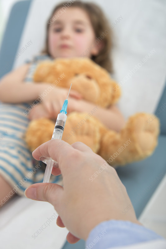 Girl in bed, person holding injection