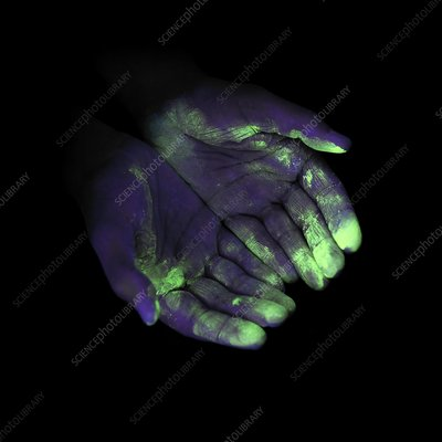 UV light showing bacteria on hands