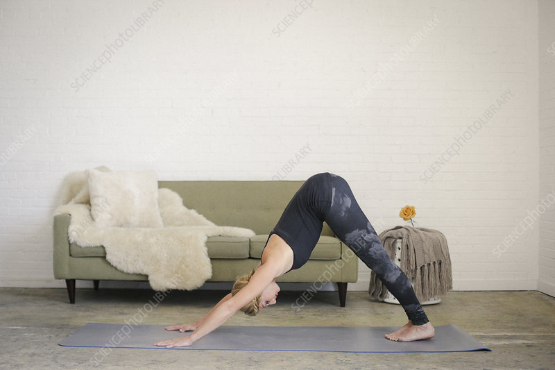 Woman on mat bending down on all fours