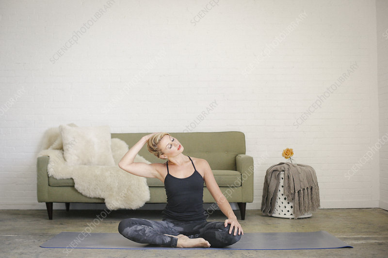 Woman on a yoga mat in a room