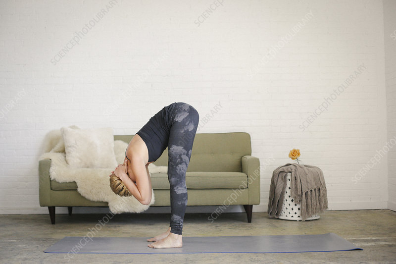 Woman stretching and bending arms raised
