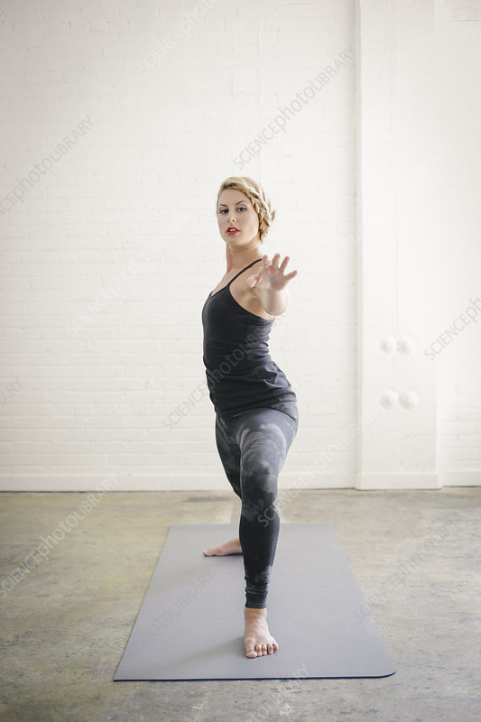 Woman bending her knees in a lunge