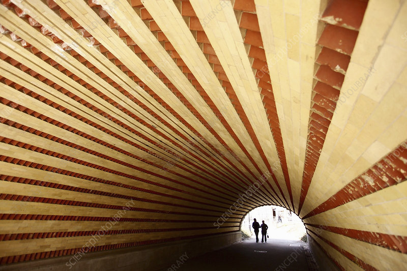 Couple walking in a tunnel, New York