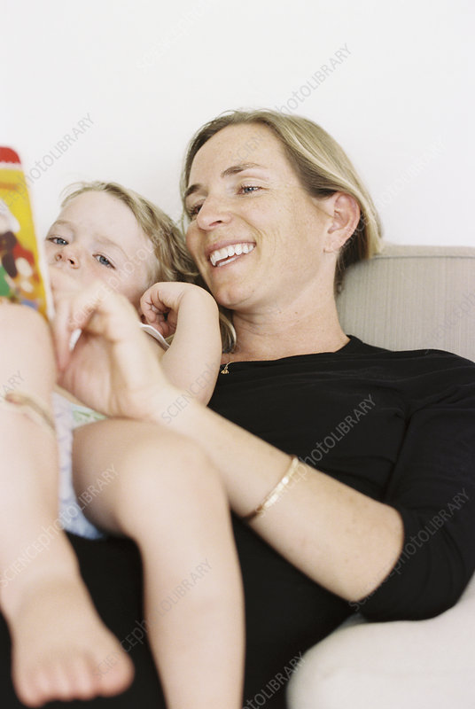 Woman reading to her son