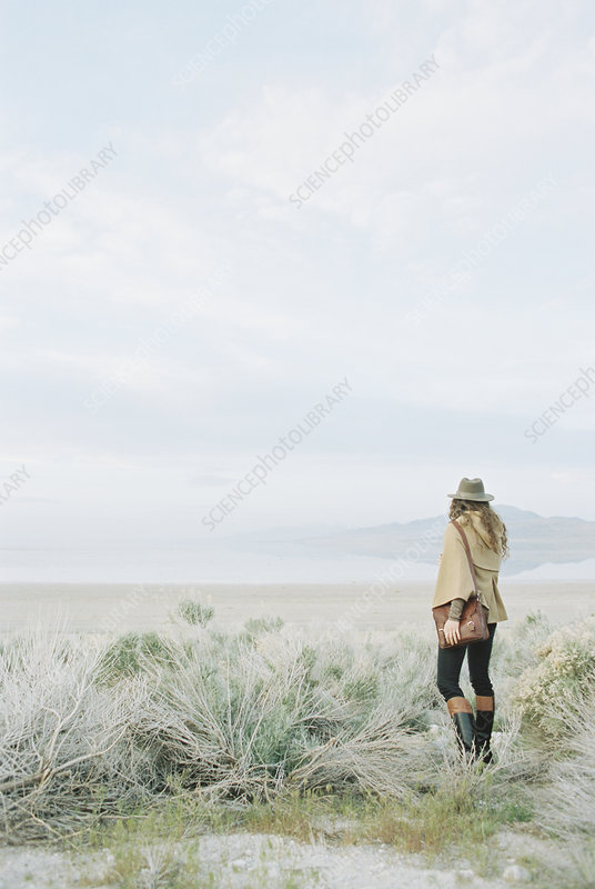 Woman standing alone in open space
