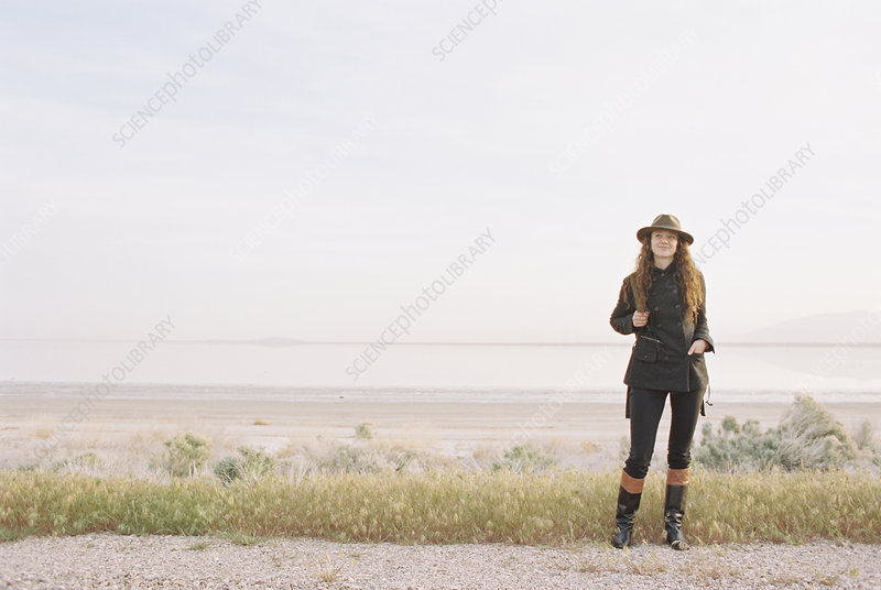 Woman standing on an empty country road
