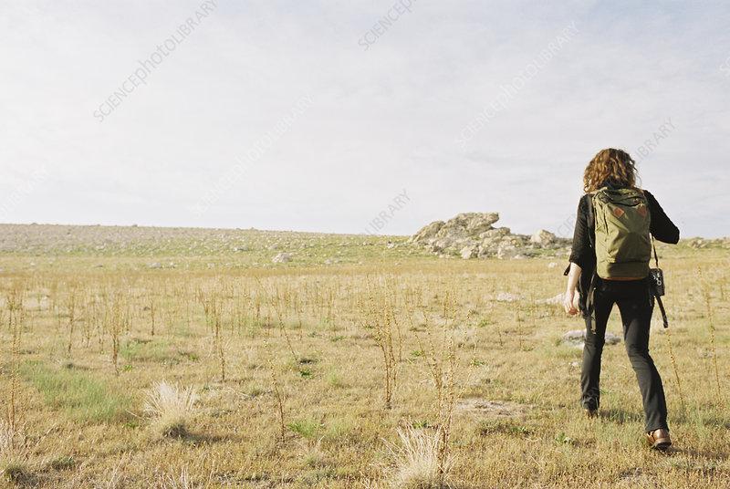 Woman walking across open ground