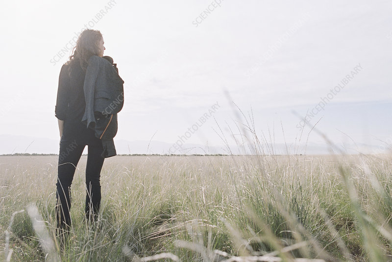 Woman standing looking to the horizon