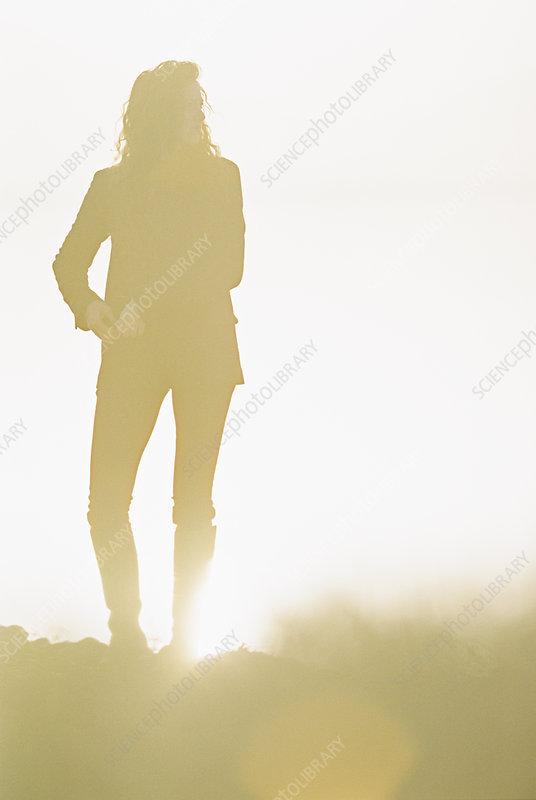 Silhouette of Woman in sunlit landscape