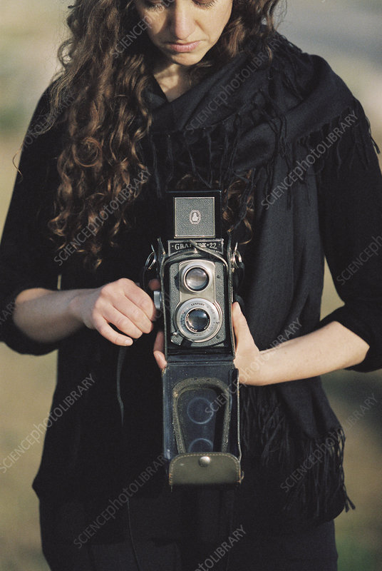 Woman using a medium format camera