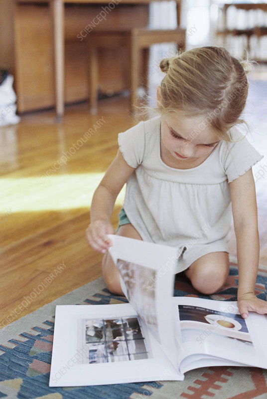 Young girl reading a lifestyle magazine