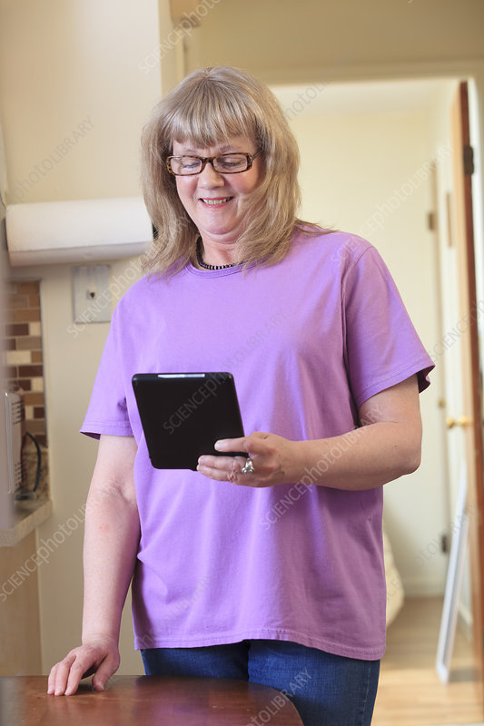 Woman with disability using her tablet