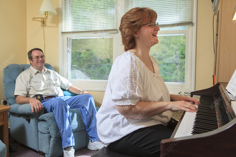 Woman with disability playing her piano