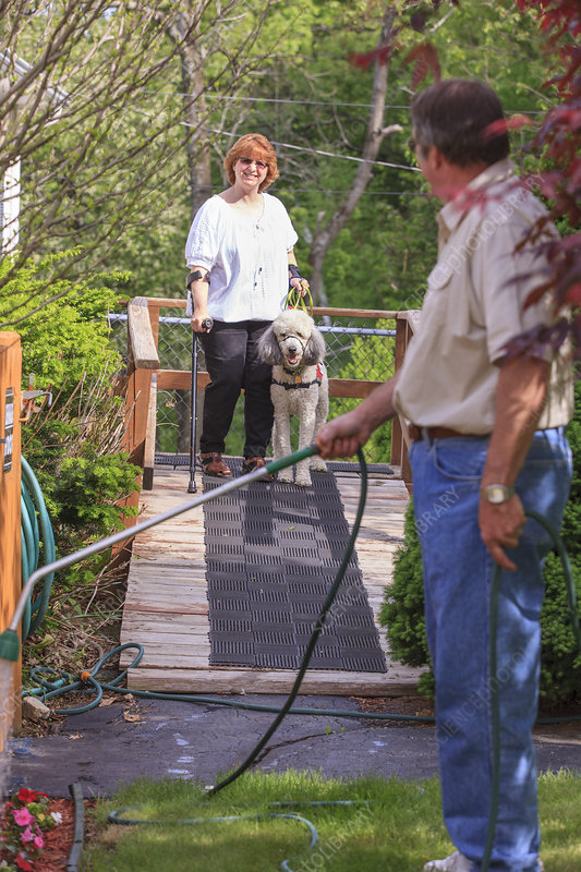 Woman and dog on her wheelchair ramp