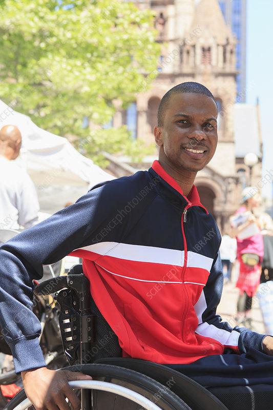 Man in wheelchair shopping at market