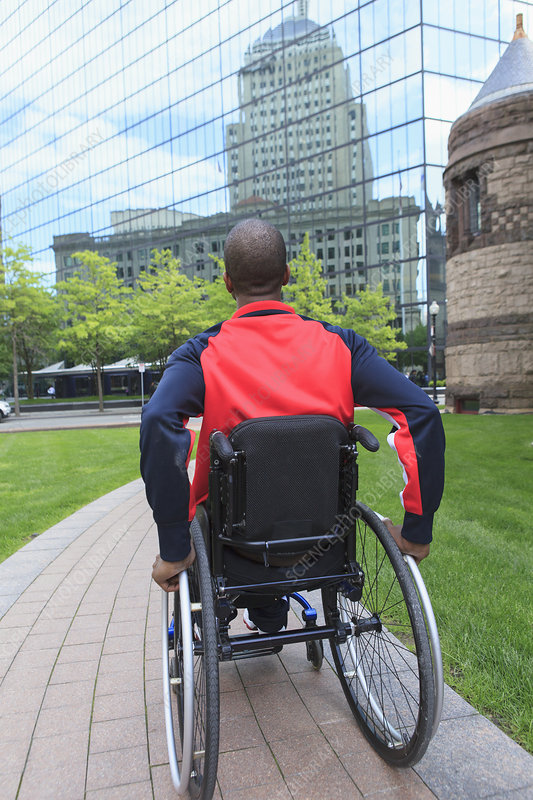 Man in wheelchair moving in the city