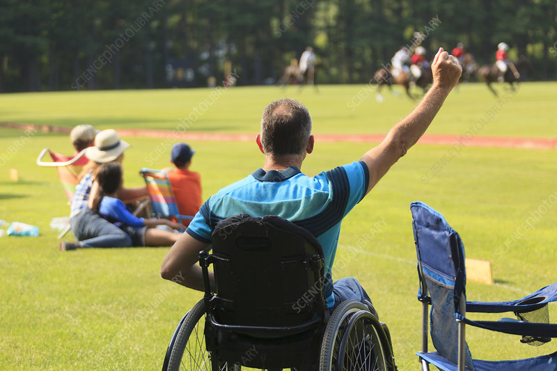 Man with disability watching polo