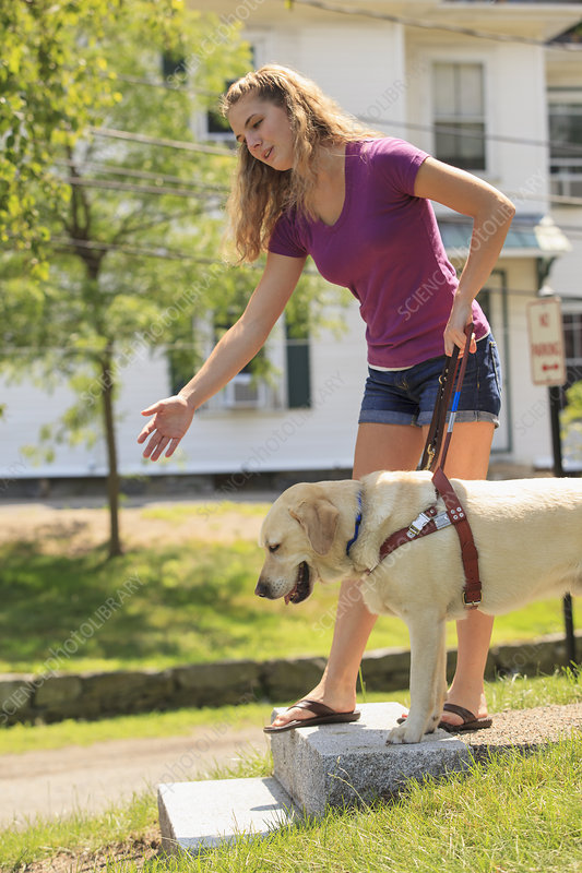 Visually impaired student with her dog