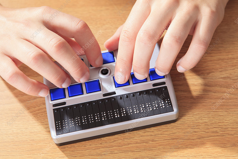 Visually impaired using Braille display