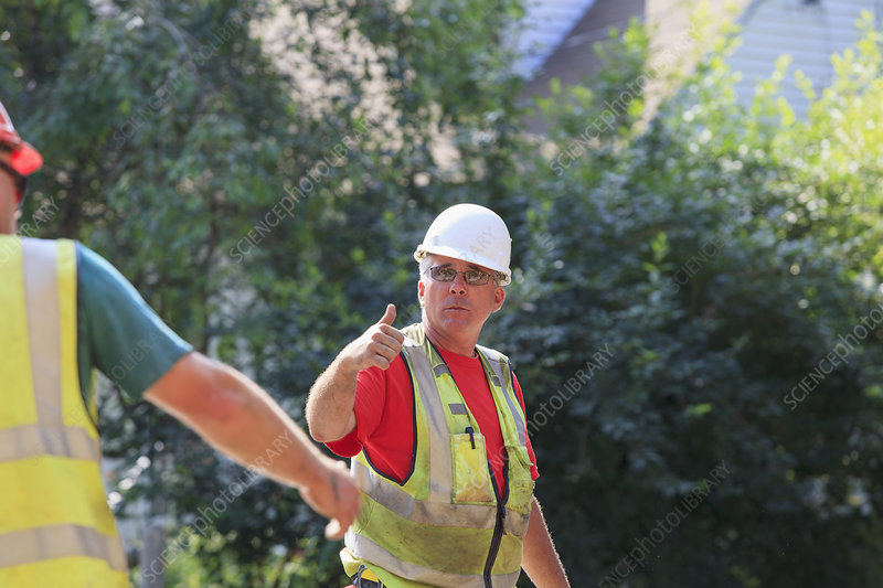 Construction supervisor giving thumb up