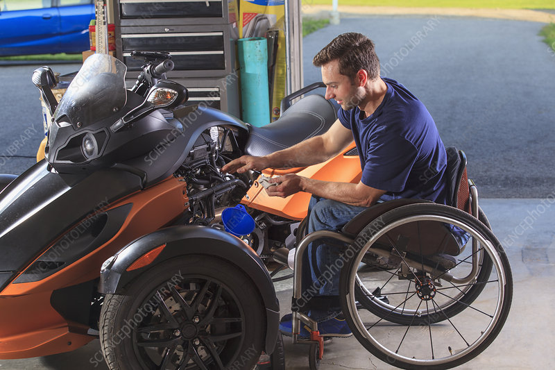 Man with disability building motorcycle