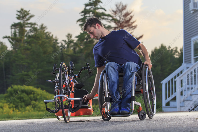 Man in his wheelchair with hand cycle