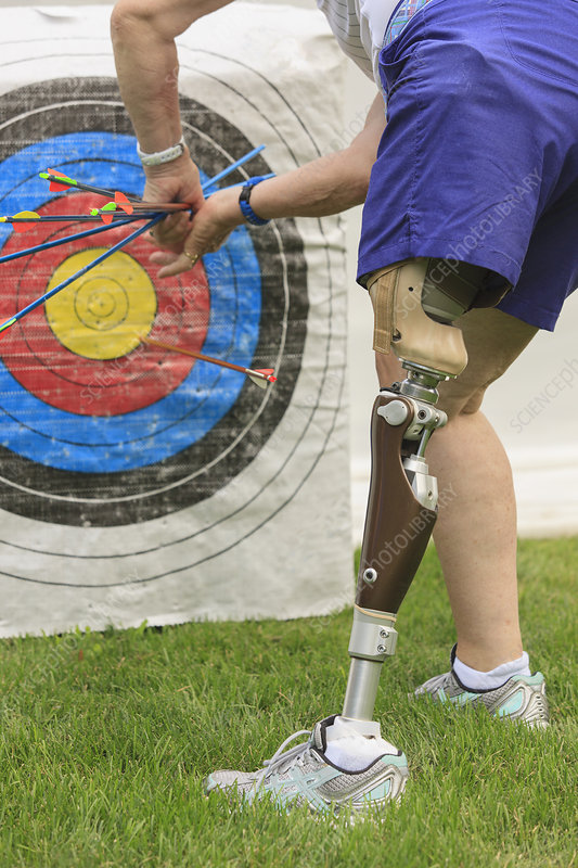 Woman with disability in archery practice