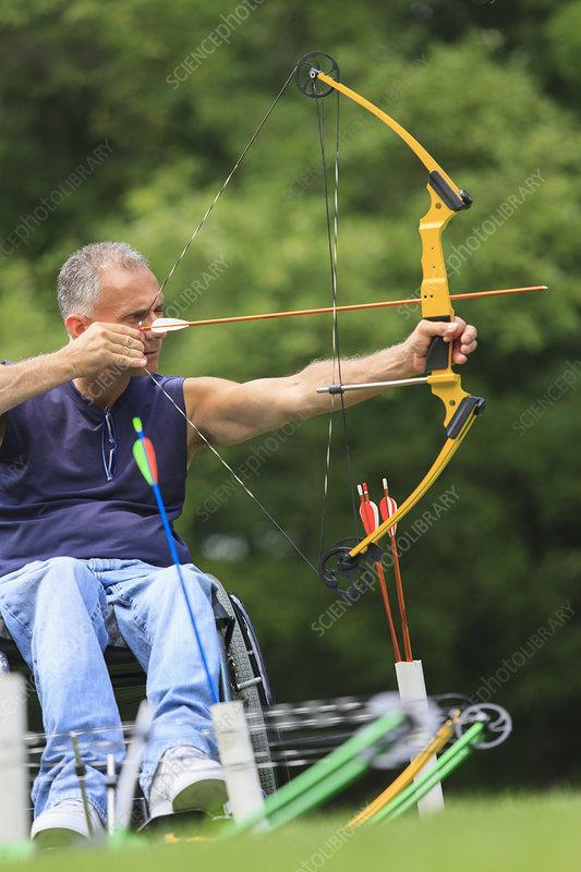 Man in wheelchair during archery practice