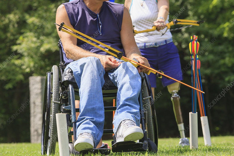 People with disability doing archery
