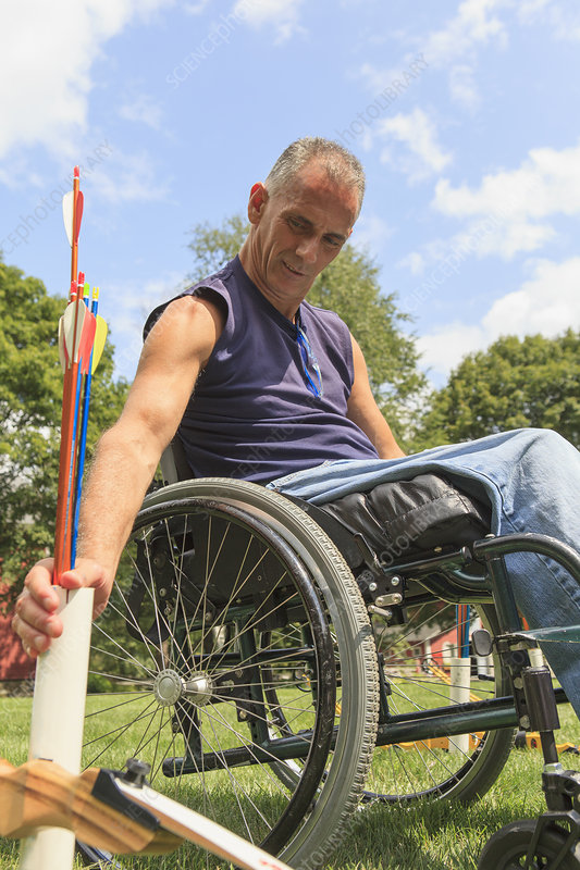 Man in wheelchair during archery practice