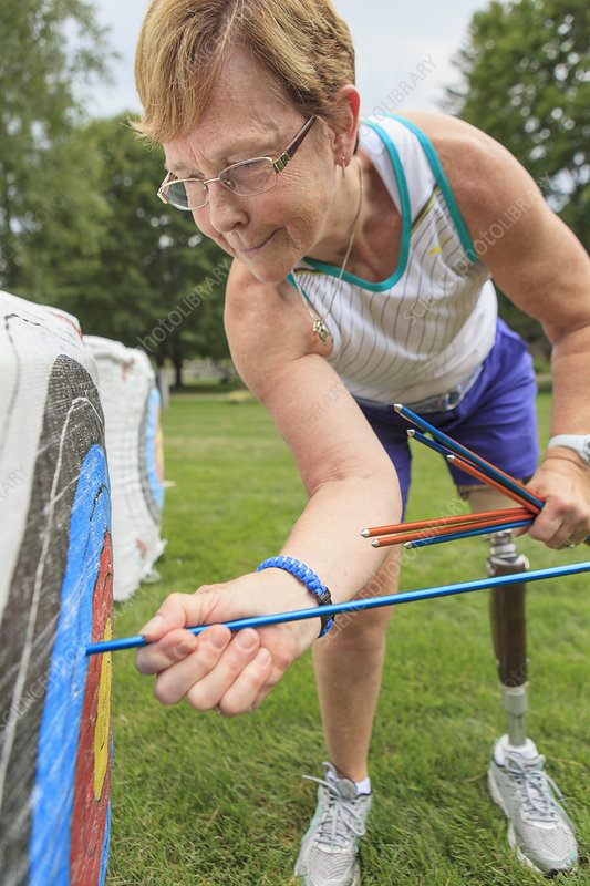 Woman with disability doing archery