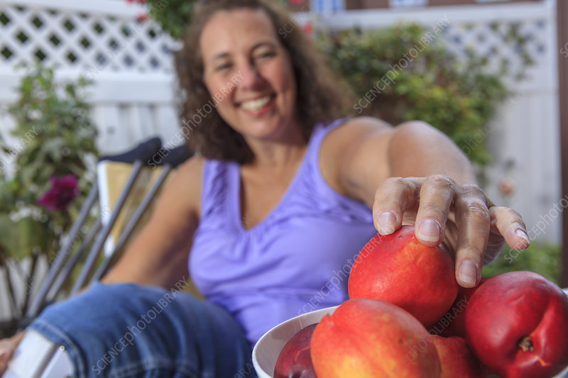 Woman with disability enjoying fruit
