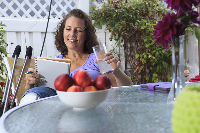 Woman with disability relaxing on patio
