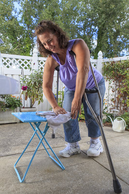 Woman with disability cleaning a table