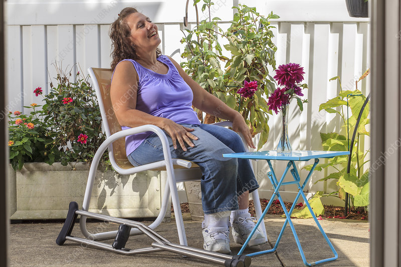 Woman with disability relaxing in garden
