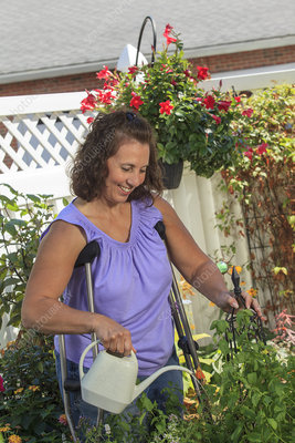 Woman with disability using crutches