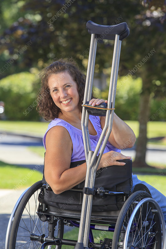 Woman with wheelchair and crutches